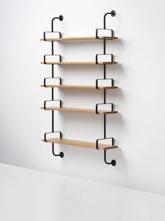 Mathieu Matégot, Démon shelf, 1954. Painted steel, walnut. Via Phillips