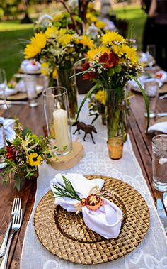 Wildflowers, distressed wooden tables and delicate lace touches add just the right amount of whimsy to a rustic inspired reception
