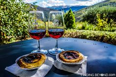 Enjoying local port wine and traditional Portuguese tarts from our room. Douro Valley, Portugal. Portugal Highlights for a 2 Week Itinerary.