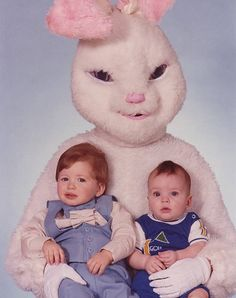 some of these Easter Bunnies are hilarious.  I LOVE the one with the Bunny trying to hold onto the girl