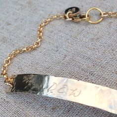This gold filled bar is 20 gauge, 2 long, and slightly curved to fit your wrist perfectly. It is hand stamped with the word, name, or phrase of