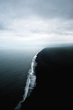 Black sands meet the ocean.