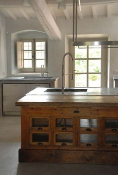 Love the windows and door, antique wood island and the simple fixtures and counter tops.  Note flooring is not wood.