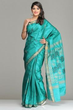 Turquoise Green Tussar Silk Saree With Gold Zari Border And Black & Beige Floral And Paisley Motifs On The Pallu