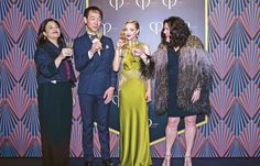"""Clé de Peau Beauté brand director Roxana Daver, Shisheido China president Kentaro Fujiwara, Clé de Peau Beauté cover girl Amanda Seyfried, and artist Ashley Longshore attend a press event in Shanghai in 2016 to announce the collaboration 