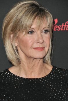 Singer/actress/icon Olivia Newton-John, who is battling cancer for a third time, was reported today to be near death, with the Australian entertainment website Now to Love claiming she had a '… Medium Hair Cuts, Short Hair Cuts, Medium Hair Styles, Short Hair Styles, Mom Hairstyles, Short Bob Hairstyles, Chin Length Hair, Hair Styles For Women Over 50, Long Gray Hair