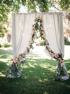 Wedding Backdrop elicate Flowers and Fabric