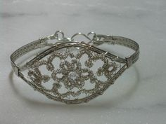 combine silver tatting with wire wrap jewelry designs from http://anotherjoyfulcreation.blogspot.com/2011/09/new-adventure-in-tatting.html