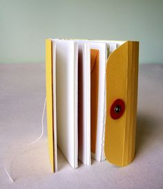 such a creative way to bind books using a little accordion folder with string clasp, so clever (via Mill Girl)