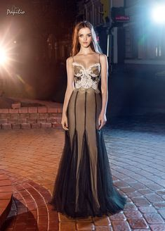A gorgeous new evening dress style which highlights your beautiful silhouette and plays off the bustier trend that is so popular right now! #eveningwear #papiliobridal #chic #fashion