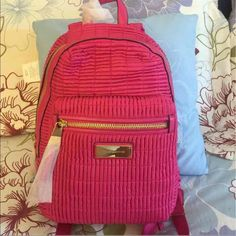 """Juicy Couture Backpack Brand New Authentic   Adjustable padded shoulder straps. Locker loop. Fully lined interior. Front zip pocket. Top zip closure. Interior zip and pouch pockets. Gold tone hardware. 9 7/8""""L x 5""""W x 11 3/4""""H Handle drop: 3 1/8"""" Shoulder strap length: 22 1/8"""" 100% Polyester, 100% PU Trim  Imported Comes from non smoking home I Paid $198+tax PRICE FIRM!! Juicy Couture Bags Backpacks"""