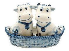 Delft Blue collectible Salt and Pepper Set of Dutch Cows in a basket featuring a windmill scene on the interior of the basket. - Hand painted - See our collection for more unique Delft Salt & Pepper S