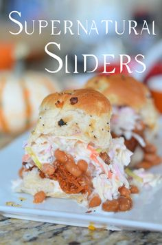Supernatural Sliders by Mooshu Jenne. These sliders are filled with beef brisket, beans, and cole slaw on a onion roll. #smokehousebbq