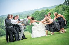 Funny Bridal Party Picture - they were actually pulling us apart!
