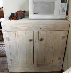 pallet wood cabinet --I love this, but would change the color