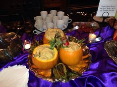 Pumpkin spiced hummus served in a hollowed out mini pumpkin at a Halloween Party catered by Heirloom Cuisine.