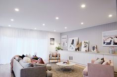 The norsuHOME - Living Room Photographer: Stu Morley  Paint: Dulux Tranquil Retreat Cabinetry: kaboodle Kitchens Flooring: Godfrey Hirst  Panelling: EasyCraft  Products: GlobeWest Vittoria Mia Sofa, Gus Margot chair, Ingrid Chair, Como Coffee table & Livorno side table, Love Warriors Sky Circles print, Donna Delaney Matilda Print, Middle of Nowhere prints, Armadillo & Co Sherpa rug, norsu cushions (all available at www.norsu.com.au)