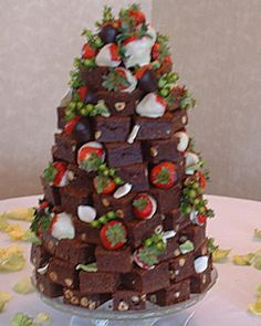 going off again on the non traditional wedding cake idea...what about a fudge wedding cake w fruit? Easy to diy n gluten free