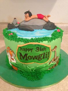 Jungle Book cake.  Vanilla with strawberry filling, buttercream, and painted/sculpted fondant.