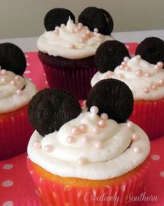 Minnie Mouse Birthday - lots of cute ideas, but I especially love the mini oreos as ears on the cupcakes!