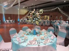 Swiss Park Banquet Center, Whittier CA Quinceanera in aqua and white deluxe linens package C+ lighting and balloons courtesy of A Special Event Decor