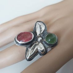 tourmaline stonerRing,statement ring.two stone ring,tourmaline jewelry,pink tourmaline,bezel set ring,one of a kind ring,gift4her This stunning nature inspired statement ring was handcrafted from Solid Sterling Silver , fine silver for the bezels and two beautiful Tourmaline stones. The Pink stone Tourmaline Jewelry, Tourmaline Stone, Pink Tourmaline, Handmade Jewelry Designs, Handmade Rings, Pink Stone, Green Stone, Bezel Set Ring, Rings For Her