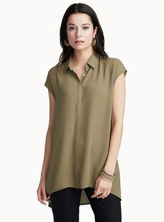 Exclusively from Contemporaine     Fashionable long design with a high-low hem, made in light and ultra fluid crepe   Wear it with leggings and skinny jeans, or try it with a bold wide-leg pant for an ultra trendy look   Feminine cap sleeves   Buttons down the front, hidden under a placket    The model is wearing size small