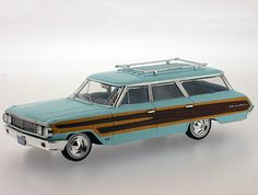 Ford Country Squire (1964) Diecast Model Car by Premium X PRD202 This Ford Country Squire (1964) Diecast Model Car is Light Blue and features working wheels. It is made by Premium X and is 1:43 scale (approx. 12cm / 4.7in long).