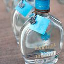 Favors of Partida Tequila with turquoise tags await each guest.