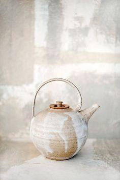 Round white tea pot