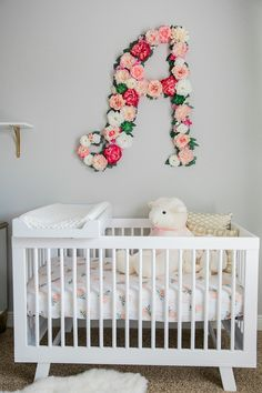 "we made her initial ""A"" to hang over her crib. I know what you are thinking, what is her name?? You will find out very soon!! I promise, as soon as she is born, only 4 more weeks!!  We bought florals from hobby lobby and glued them to a wooden cutout ""A"" that my dad made. I just loved the way it turned out. My approach in her room was to splurge on one or two elements and then fill the rest with antique store finds or DIY artwork."