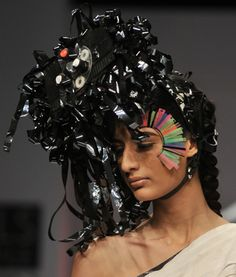 """Collection: Conditions Apply II  Materials: Videotape, Videotape reel, Switches.  Story: This headgear is inspired from the story """"accidents"""". A scattered, chaotic composition of the headgear depicts an accident scene.  #fashion #recycle #headgears #nitinbalchauhan"""