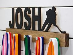 Looking for a unique gift for the hockey player in your life? This personalized hockey medal holder will be the perfect way for them to display all of their well-deserved awards. This design comes in a variety of colors, or you can pick from our other choices of sports or phrases so we can customize it just the way you want!