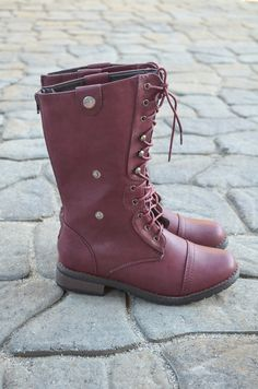 Versatile combat boots that can be worn standing up or folded over, switch it up for freshness and fun!  Import Item.