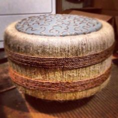 Colin made an ottoman out of tires, twine, and fabric!