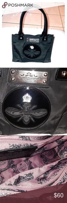 My flat in London bag My flat in London bag. Used condition but in great shape. Inside is in used condition. Very cute bag with signature logo.  Measurement are in  pictures, smoke-free home ask questions as all sales are final, it is a smaller bag happy poshing. My Flat in London Bags