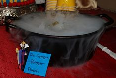 Queen's punch - another bad link, but I think the picture here gets it across. Dry ice, punch, evil queen next to the sign. My daughter would love that.