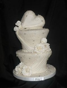 White on White Winter Wonderland Wedding Cake with a Heart Theme