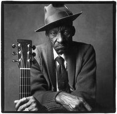 "James ""Son"" Thomas. Mississippi Delta blues guitarist and sculptor of heads with human teeth. Youtube him playing... mesmerizing."
