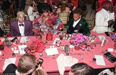 Smile for the camera: Rhianna was NOT amused as she posed for the camera at her table with Lewis Hamilton
