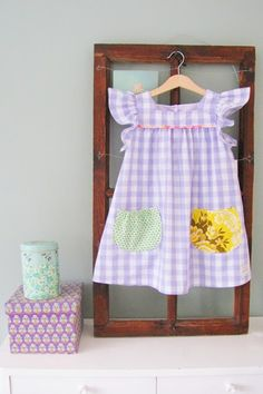 not a tute, just inspiration on how to use vintage fabrics to add charm to a dress