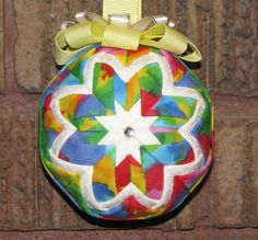 A bright, colorful new folded star Christmas  or anyday ornament