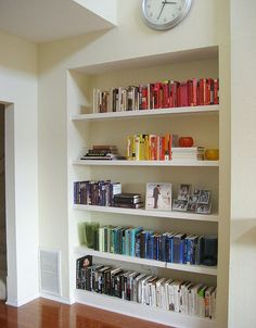 color coated builtin shelves! Even with few books you still can do it:)