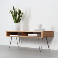 This minimalist, versatile table can double as a coffee table or as a TV stand, or it can be simply used as a low sideboard or bench. We make this design in a selection of beautiful hardwoods including solid European oak, dark stained ash and walnut. Solid Oak Coffee Table, Low Coffee Table, Solid Wood Tv Stand, Hairpin Leg Coffee Table, Solid Oak Furniture, Wood Furniture, Furniture Design, Low Sideboard, Wooden Plugs