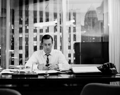 Don Draper checks his iPhone (Crop of an on-set photo from Mad Men, by James Minchin III)