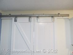 Great post on how to use parts from Tractor Supply to hand sliding barn doors. Cost is a fraction of usual track hardware that can run several hundred dollars per door. DIY Barn Doors (22)