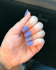 Matte lavender nails with gold striping tape.