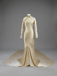 A wedding dress by Charles James...  Look at the fit.    Charles James, 1934    The Victoria & Albert Museum