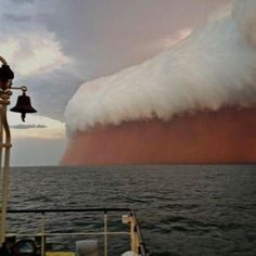 This rare and fascinating site is actually a dust wave that hit the Australian coastline  --  links - http://www.facebook.com/photo.php?fbid=10151651227748677=a.453208868676.239413.805278676=1