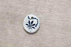 Ceramic pendant, glazed pendant, flower pendant, floral pendant, ceramic disc by BlackRabbitCeramics on Etsy Porcelain Clay, White Porcelain, Ceramic Pendant, Flower Pendant, Pendants, Ceramics, Beads, Floral, Handmade